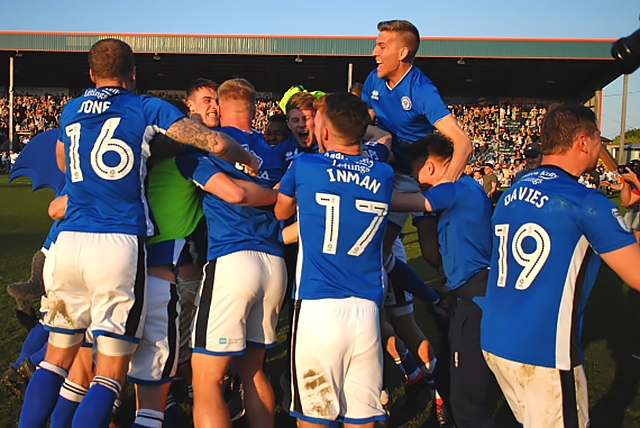 Rochdale players celebrate avoiding relegation