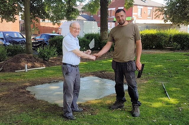 A job well done: Councillor Sheerin and Paul Ellison after the concrete is laid