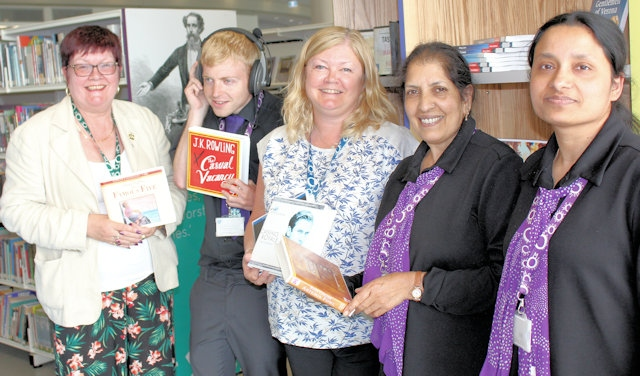 Councillor Janet Emsley (left), cabinet member for libraries, with council library staff