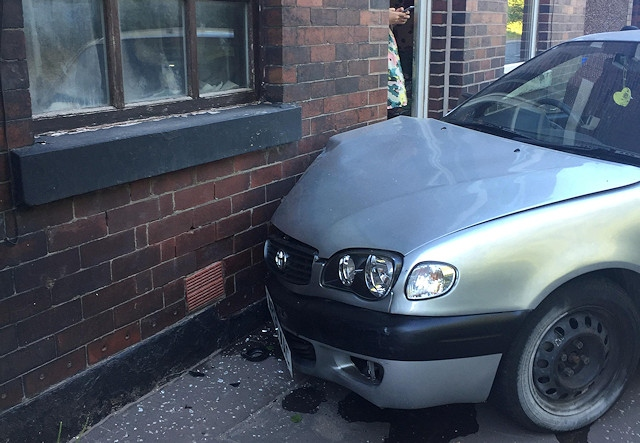 One car collided with a house