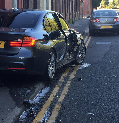A grey BMW 335D collided with a silver Toyota Corolla
