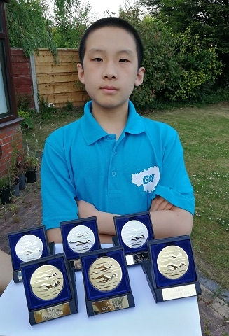 Xaunming Guo with his medals from the County Inter Association Swim Meet in June