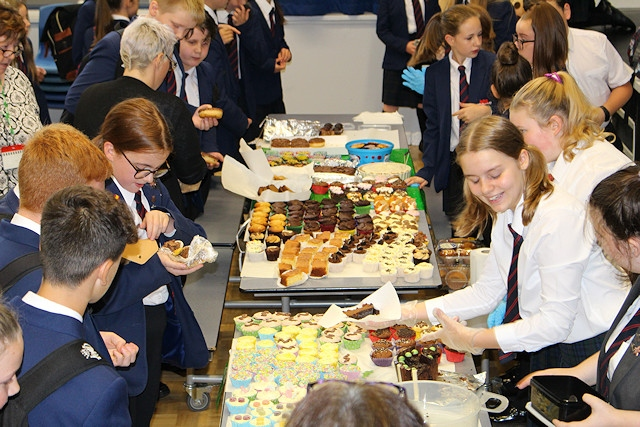 Whitworth Community High School's charity group holding their Macmillan Coffee Morning