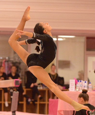 Martel Emberga performing on the floor at the Pink Ladies 4 Piece Gymnastics Competition in Durham