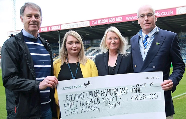 Representatives from Rochdale Children's Moorland Home with their cheque