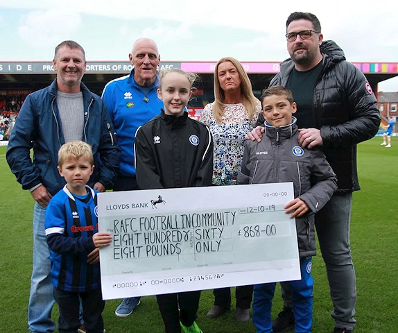 Dale In The Community Sports Trust with their cheque