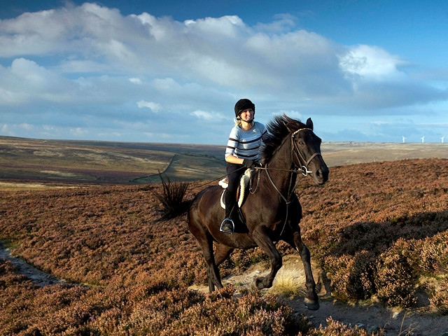 Horse rider gallops across the South Pennine landscape, cited in a government report on the nation's most precious areas