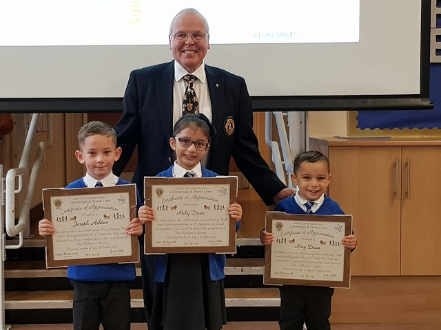Ruby Dean, six, her little brother Rory, four, and best friend Joseph Ashton, five, were presented with certificates by Harry Hawksworth, Club Treasurer of Littleborough & District Lions