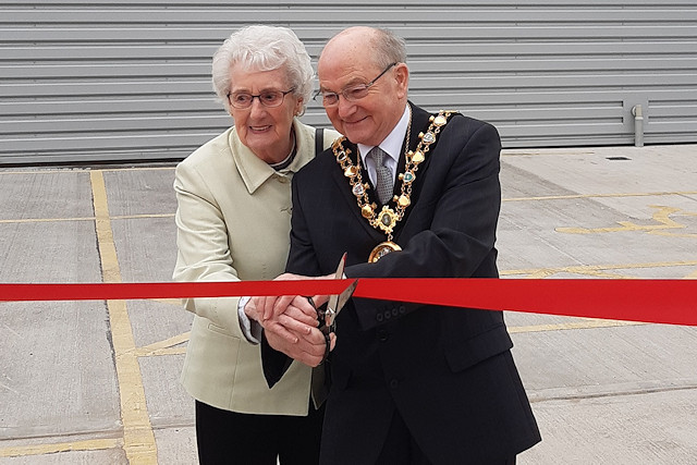 Mayor Billy Sheerin cuts the ribbon with owner and Chief Executive Phil Cornell's mum