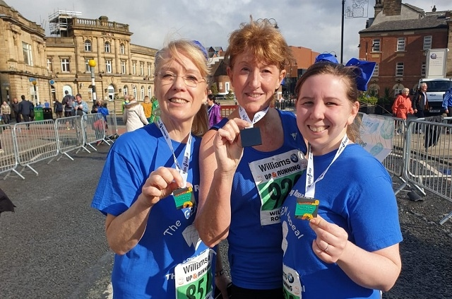 L-R: Karen, Wendy and Katie show off their medals