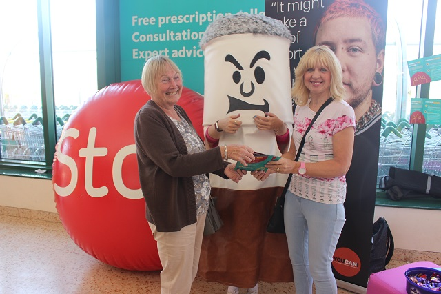 A potential quitter, Bertie Butt and a Living Well stop smoking advisor at the Hits Radio roadshow
