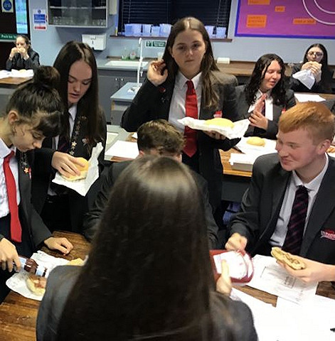 Form 11F celebrate almost 100 per cent attendance with bacon and sausage butties