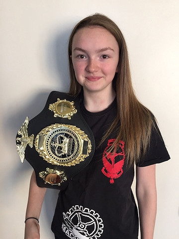 Thai Boxer Abbie Hughes with her British Championship Belt