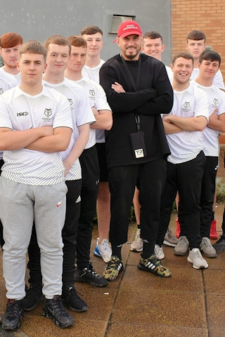 Sonny Bill Williams with students from Hopwood Hall College's Rugby Academy