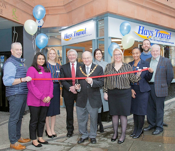 Deputy Mayor Billy Sheerin cuts the ribbon, with Lorenzo O'Reilly, Alima Ahmed, Kim Fazackerley, Rochdale MP Tony Lloyd, Rachel Byrne, Toni Smith, Amanda Wrigglesworth, Paul Ambrose, and Allen Brett, Leader of the Council