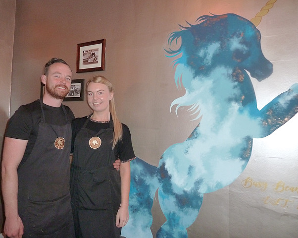 Becky and Danny O'Neill with their unicorn logo