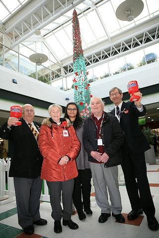 L-R: British Legion members Peter Clay, Sylvia Taylor, Gordon Wharton and Peter Round with Alima Ahmed-Zaman, Operations Assistant for Rochdale Exchange (centre)