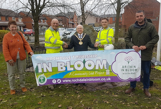 Balfour Beautty with members of Rochdale In Bloom and a banner