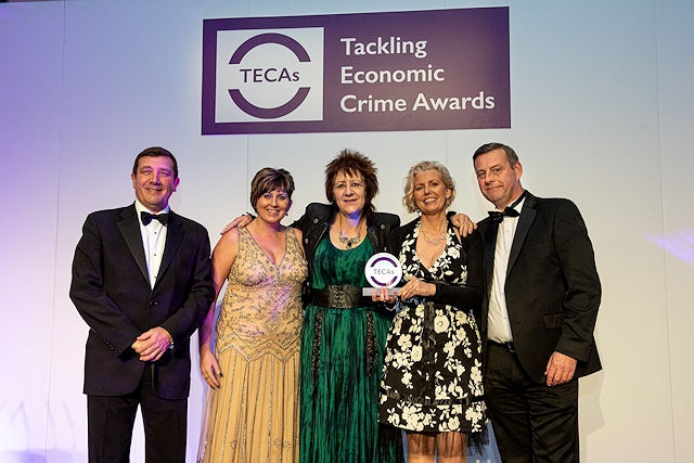 CECA's team members accepting their TECAs award