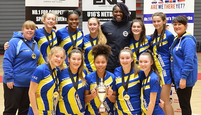 Emma and her Tameside teammates with the trophy