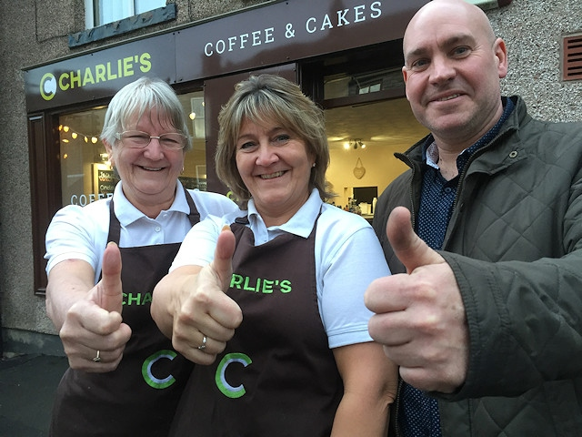 Charlie's Café owner Tracy Charlson (centre) and mum Margaret are welcomed to Wardle village by Julian Farnell
