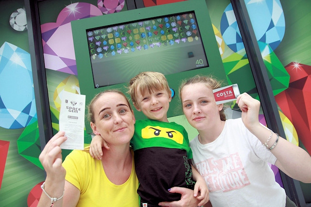 Charlotte Teasdale poses with son Oscar Teasdale (5) and daughter Tamara Cain (15) have a go at Rochdale Exchange's life-size intergalactic, interactive game that was part of the centre's 40th birthday celebrations