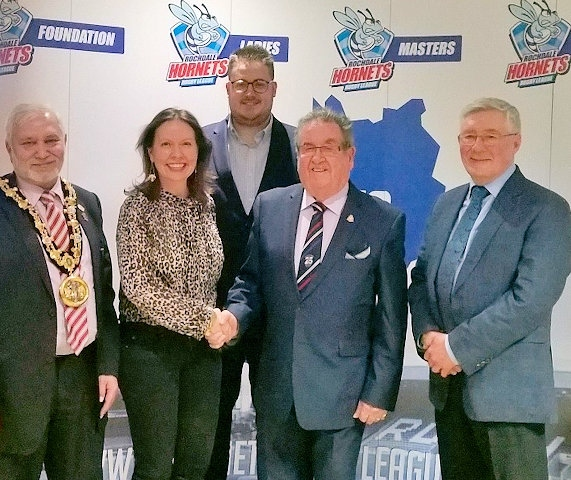 Chairman of Rochdale Hornets, Peter Rush (second from right) welcomes Rebecca Argyle director of Toronto Wolves, Cllr Blundell, Mayor Mohammed Zaman and Tony Lloyd MP to Hornets