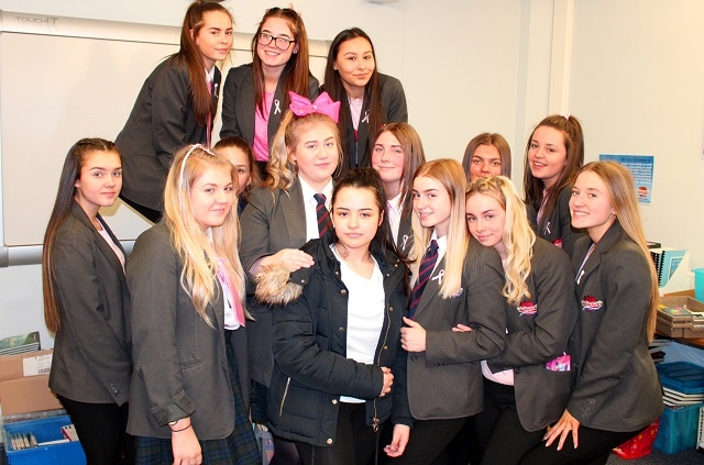 Millie O'Shea (centre) and her friends who raised money at Whitworth Community High School