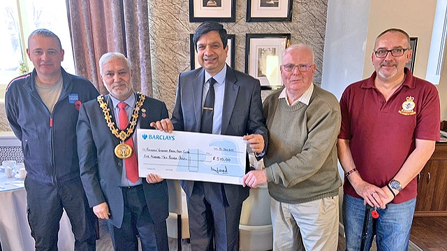 Councillor Faisal Rana and Mayor Mohammed Zaman, present the cheque to Wing Commander David Forbes DL MBE