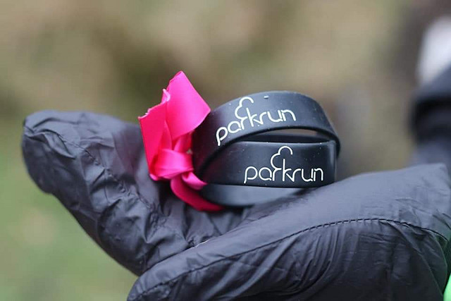 Garry also buried the parkrun wrist bands that they each wore under the tree, tied together with a pink ribbon