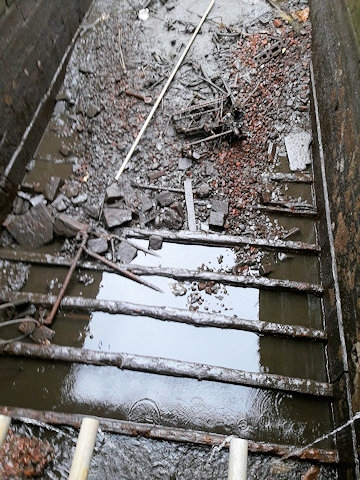 Lock 50  chamber on Rochdale Canal dewatered showing missing wooden floor
