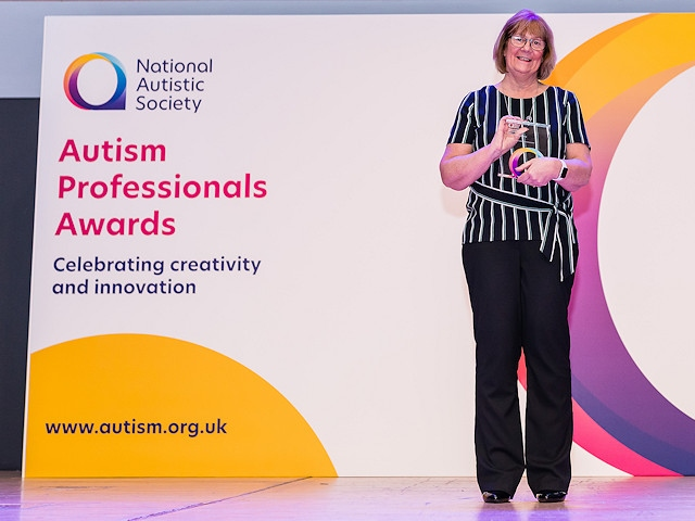 Julie Dalton collecting her award at the event