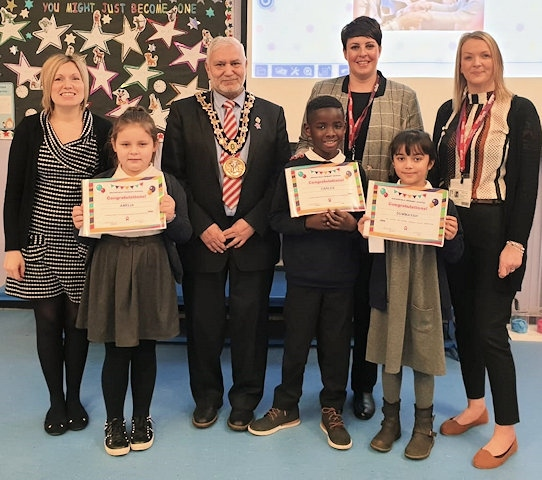 Assistant Headteacher, Emma Gaunt; Amelia, Year 3 student, Mayor Mohammed Zaman, Carlos, Year 3 student, Caroline Flood; care manager, Summayah; Year 3 student and Rachel Kershaw; deputy care manager