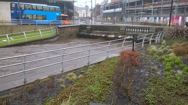 River Roch in Rochdale town centre is dangerously high, with the river just inches/centimetres from the top of the of the bridge at One Riverside and Rochdale bus station - 3.00pm Saturday 16 March 2019
