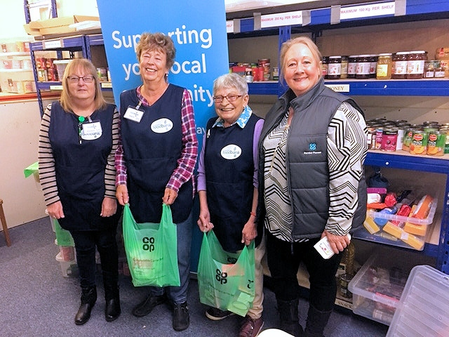 Rochdale Foodbank volunteers with the compostable Co-op carrier bags