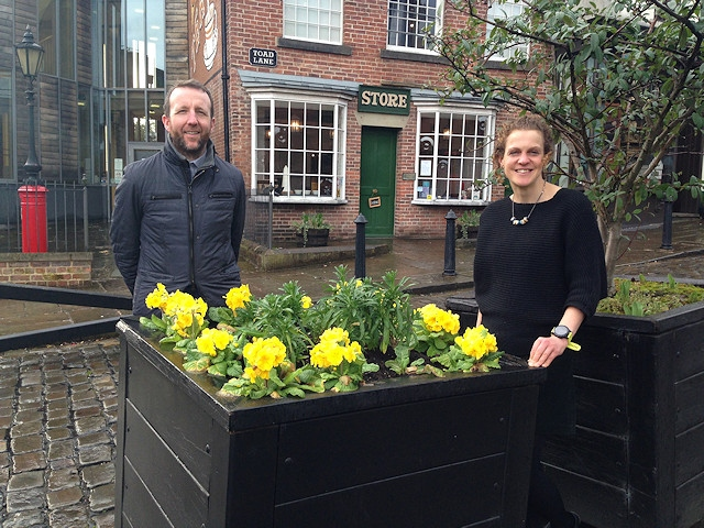 Cat Jessop with Paul Ambrose, of Rochdale Town Centre Management, by one of the planters earlier this year