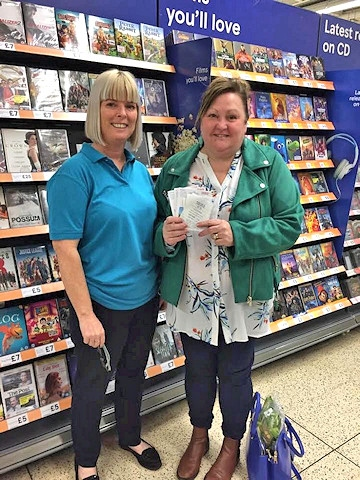 Louise Kershaw, from Crimble Croft Community Centre, receiving a months' worth of food vouchers from Angie Gilbertson, of the SG6 Foundation, on behalf of a member of the local community.