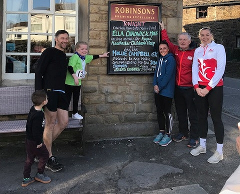 Ella Chadwick (third left) and Mollie Campbell (far right) with race organiser Andy O'Sullivan (second right) with runner Helen Smith (third right) and Will Smith (second left)