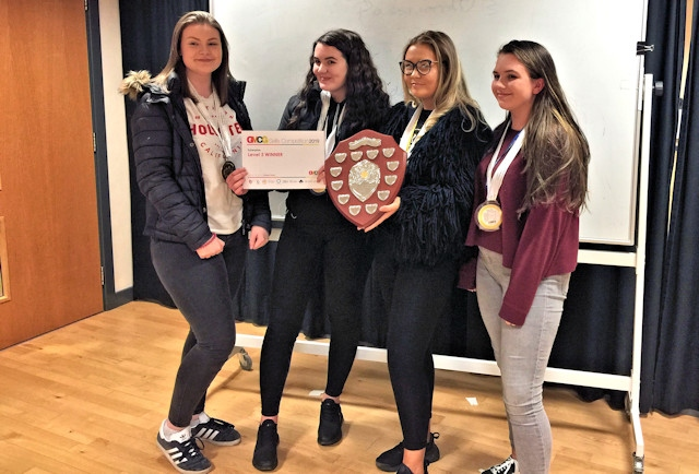 Business students at Hopwood Hall College retain the Overall Champions Shield