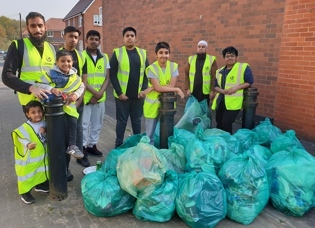 Volunteers of all ages come together to help clean up the Wardleworth area of Rochdale