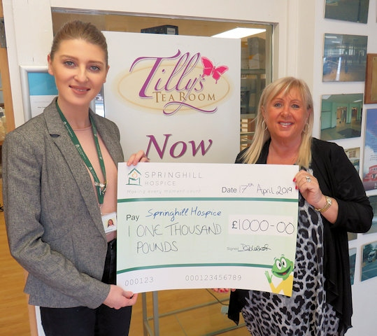 Sophie Ansley, Corporate and Partnership Fundraiser for Springhil Hospice with Debbie Goldrick presenting the cheque