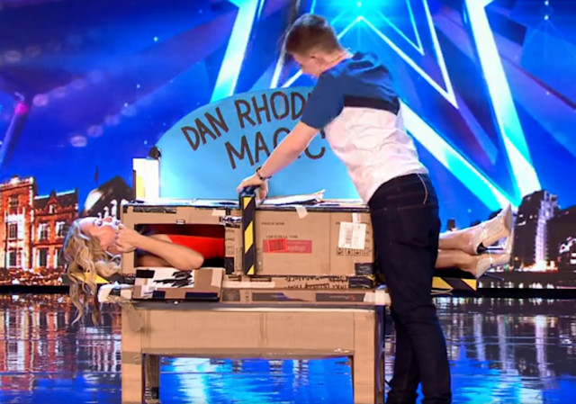 Using his homemade box, Dan asked judge Amanda to climb inside