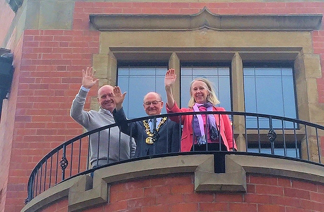 Mayor Billy Sheerin and MP Liz McInnes wave from the Carnegie Building