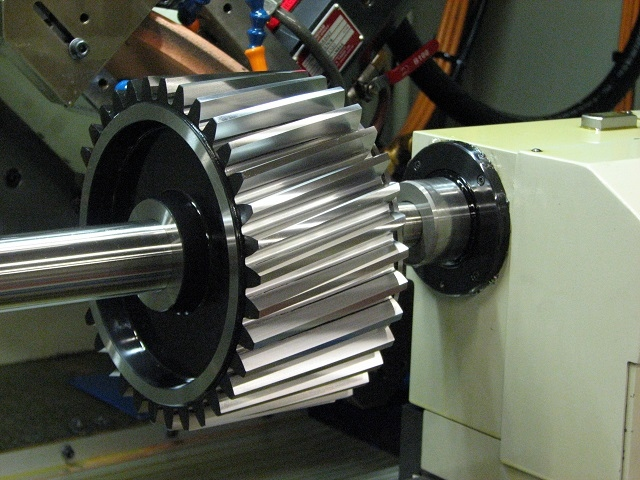 Precision grinding of a large face width pinion gear