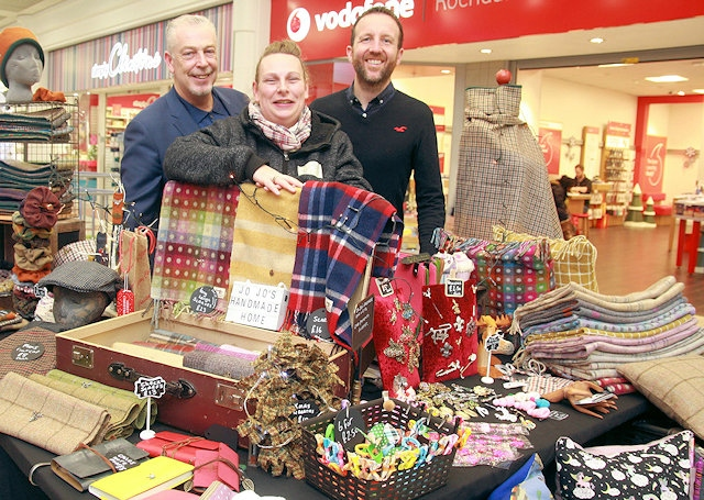 Rochdale Exchange Shopping Centre manager, Lorenzo O'Reilly with Paul Ambrose, Town Centre Manager and Joanna Jones, selling her gorgeous range of scarves helping to raise money and awareness for Heart Ormand Street Hospital