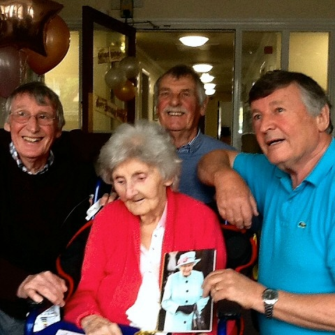 Catherine (Ena) with her three sons: Paul (left), eldest Peter (back) and the youngest Jeff (right) and her 100th birthday card from the Queen