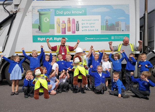 Children from Healey Primary School with Rochdale Council recycling officers