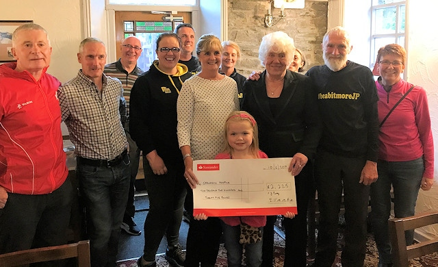 Ella Chadwick presents a cheque to Springhill Hospice
