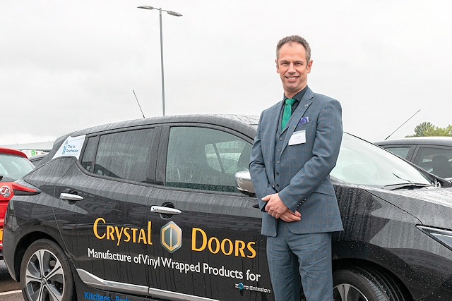 Richard Hagan, managing director, Crystal Doors, with his electric Nissan Leaf car