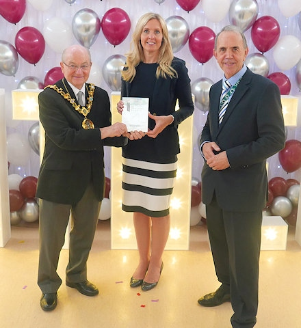 Mayor Billy Sheering and Councillor Kieran Heakin at Kentmere Academy presenting Headteacher, Mrs Sarah Isberg with the Pearson Silver Teaching Award trophy